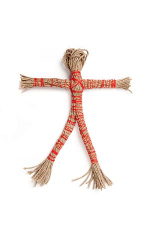 Traditional rope doll used in magic, isolated on white. photo