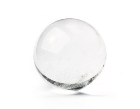 Natural quartz crystal ball - used for fortune telling. Isolated on white.