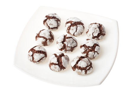 crinkles: Chocolate crinkles on a white plate, isolated. Stock Photo