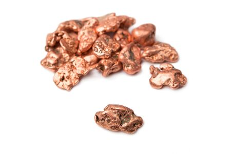Copper nuggets - in a heap and one aside, isolated on white.