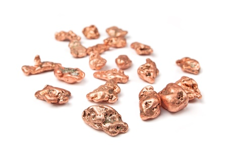 metallurgy: Little copper nuggets sparced on white background. Stock Photo