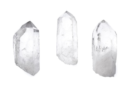 Three big natural quartz crystals isolated on white. Stock Photo - 9585679