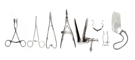 Surgical instruments in a row isolated on white. Stock Photo