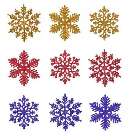 Miscellaneous glitter snowflakes of various colors isolated on white (digital collage).
