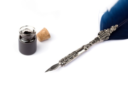 nib: Antique quill and black ink on white paper.