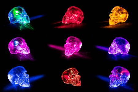 Transparent glass skulls with light beams against black background. Stock Photo - 9970253