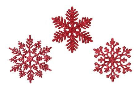 Three different red glitter snowflakes isolated on white. Stockfoto