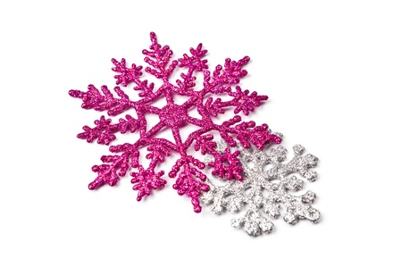 Two glitter snowflakes - pink and silver - isolated on white.