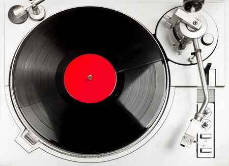 Turntable - dj's vinyl player with a red vinyl disk on it, view from above. Stockfoto