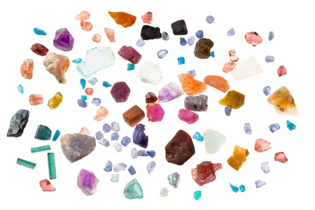 Rough precious and semi-precious stones - ruby, sapphire, emerald, tourmaline, opal, apatite, aquamarine, iolite, spinel. Isolated on white. photo