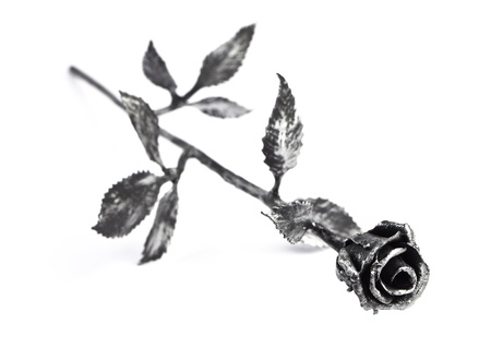 Hand forged metal rose with silver accents on petals, isolated on white. photo