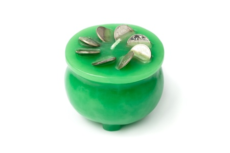 magick: Money drawing magick - green candle with silver coins in it.
