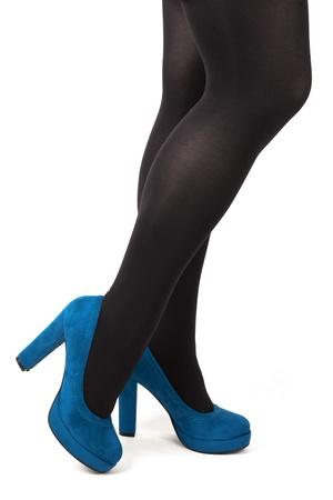 panty hose: Sexy legs in turquoise blue high heels and black tights isolated on white background.