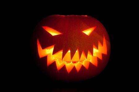 Jack-o-lantern, smiling Halloween pumpkin glowing in the night. photo