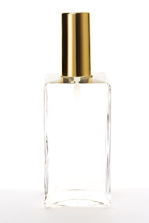 Blank perfume bottle with golden cap isolated on white. Stock Photo
