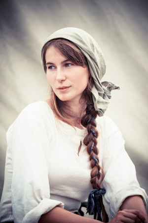 historical events: MOSCOWRUSSIA - JUNE 23: Medieval woman in traditional dress during the great international festival of historical reconstruction Times & Epochs  shown on 06.23.2013 in park Kolomenskoye. The festival is held each year.