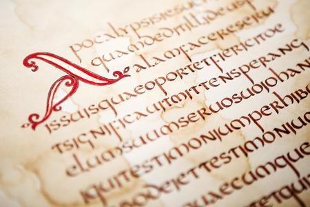 Calligraphic handwritten excerpt from Bible on a grunge paper, shallow dof. 写真素材
