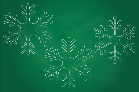 green chalkboard: Three white chalk snowflakes over green chalkboard.