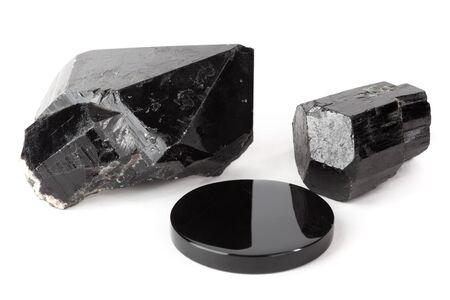 mined: Three black stones: black quartz crystal, black tourmaline crystal and black obsidian mirror.