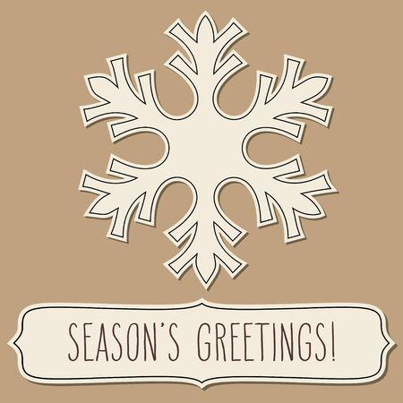 seasons greetings: Carta tagliata fiocco di neve e un telaio con i saluti scritta a mano della stagione su sfondo vintage marrone.