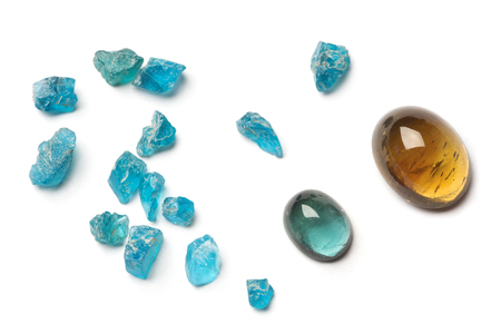 lapidary: Misc apatite gems, rough and cabochons, isolated on white. Stock Photo