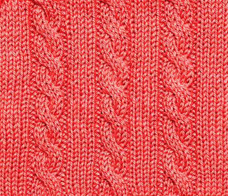 interlink: Woolen red knitted background - winter theme. Winter Christmas warm background. Stock Photo