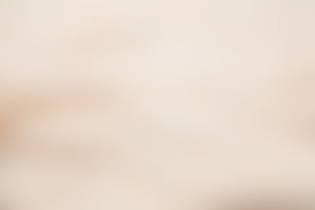 Beige abstract smooth blur background for any design to put over.