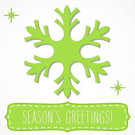 seasons greetings: Bright green snowflake and a frame with hand written seasons greetings, isolated over white.
