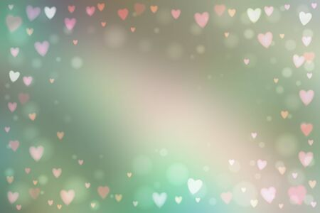 heartshaped: Abstract blur pastel background with small heart-shaped lights over it.