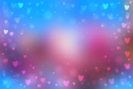 heartshaped: Abstract smooth blur blue and pink background with small heart-shaped lights over it.