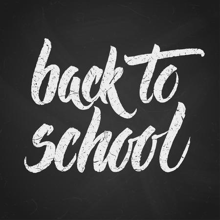 handwritten: Handwritten Back to school words over black chalkboard. Illustration