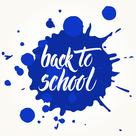 splattered: Back to school words hand written by brush, white over blue ink blots.