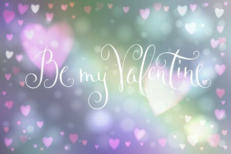 heartshaped: Abstract smooth blur background with heart-shaped lights over it and hand written Valentines day greetings.