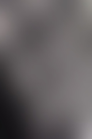 vertical format: Abstract smooth blur dark gray background for any design to put over. Vertical format.