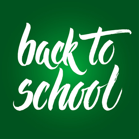 intermediate: Back to school words hand written by brush, white over green.