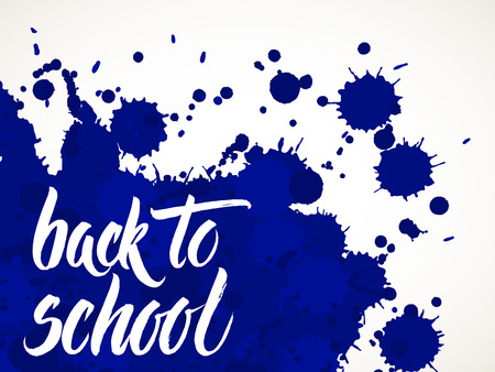 Back to school words hand written by brush, white over blue ink blots.