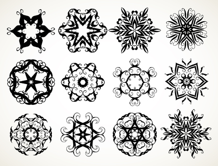 Set of ornate lacy doodle floral round rosettes in black over white backgrounds. Mandalas formed with hand drawn calligraphic elements. Illustration