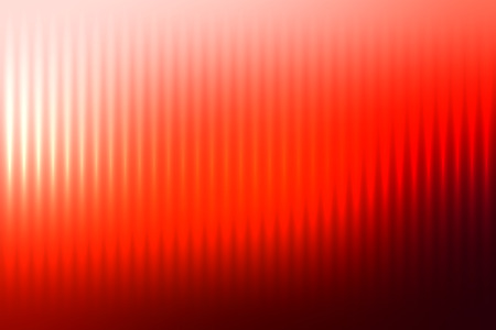 Red abstract blur colored background with defocused vertical rays of light.