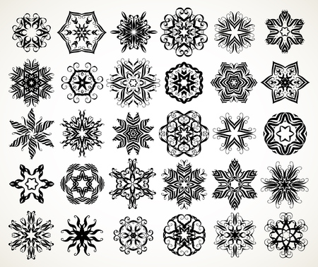 Set of ornate lacy doodle floral round rosettes in black over white backgrounds. Mandalas formed with hand drawn calligraphic elements.  イラスト・ベクター素材