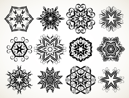 Set of ornate lacy doodle floral round rosettes in black over white backgrounds. Mandalas formed with hand drawn calligraphic elements. Stock Illustratie