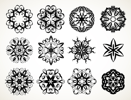 Set of ornate lacy doodle floral round rosettes in black over white backgrounds. Mandalas formed with hand drawn calligraphic elements. Ilustração