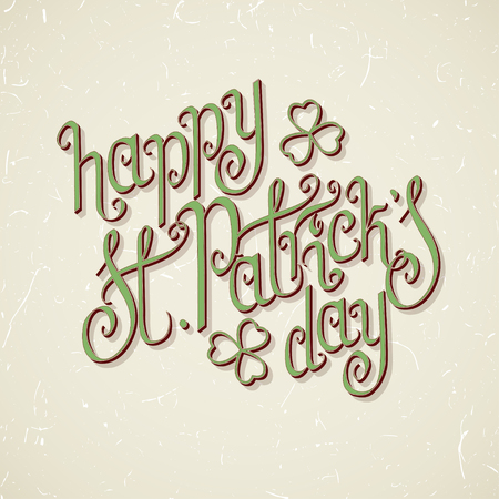 Hand written St. Patrick's day greetings over textured vintage beige background.