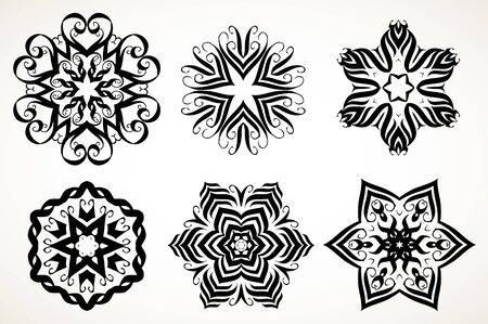 Set of ornate lacy doodle floral round rosettes in black over white backgrounds. Mandalas formed with hand drawn calligraphic elements. Illusztráció