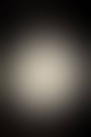 Abstract smooth blur dark gray background for any design to put over. Vertical format.