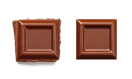 Two square pieces of chocolate bar, one rough and one neat, isolated on white.