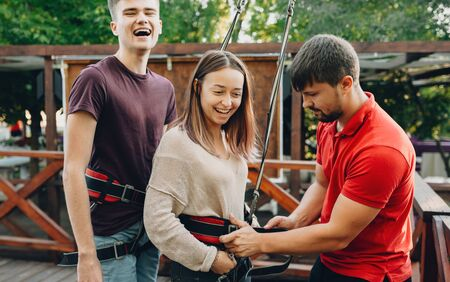 Young caucasian couple looking for new feelings ready to go down on a ropeway are smiling and waiting for it Stok Fotoğraf