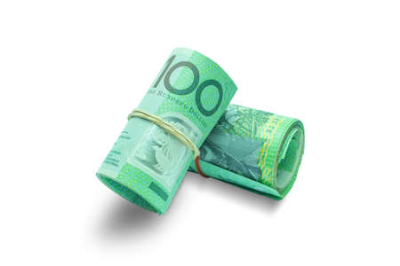 one hundred dollars: Rolled Australian banknotes isolated on white background with clipping path.