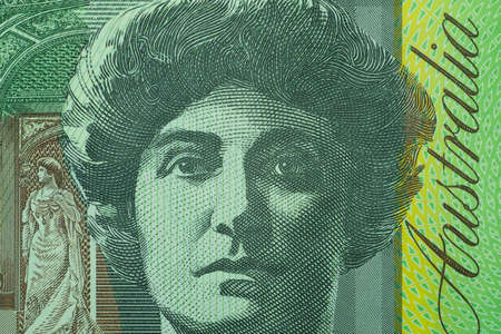 Close up on Australian dollar banknotes. Portrait of Nellie Melba on 100AUD banknotes. Shooting by 1:1 Macro lense for detail of Face, number etc. on banknotes.