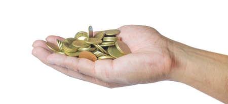 Mannelijke hand die gouden muntstukken houdt. Sparen, geld, financiën donatie, geven en bussiness concept. Geïsoleerd op witte achtergrond Stockfoto