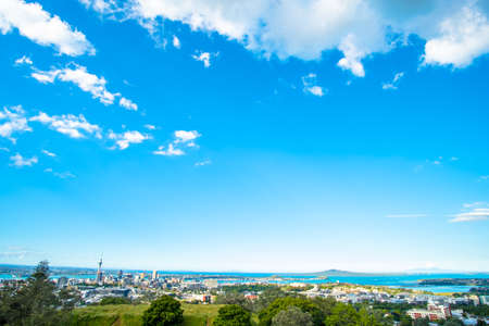 Landscape of Auckland City, New Zealand with the sea, tower, blue sky and cloud.  View from Mt. Eden